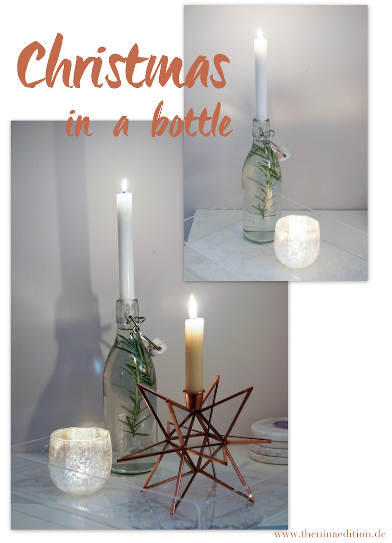 Rosmarinzweig in einer Flasche als Kerzenständer als Weihnachtsdekoration