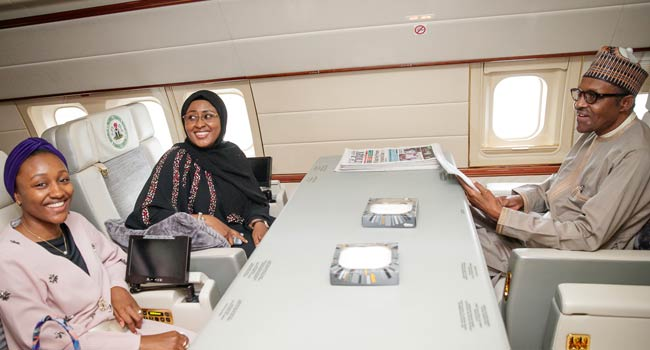 News In Picture: President Buhari, Wife, Aisha And Their Daughter Inside Plane Traveling To China
