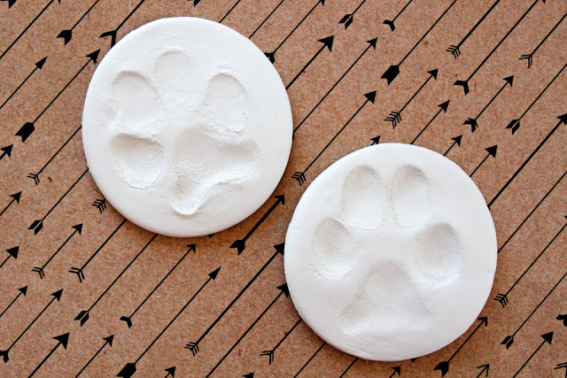 DIY pet paw prints in round pieces of air dry clay