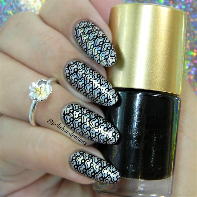 Beauty Bigbang XL-001 black shell pattern stamper over  silver holo base