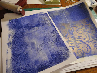 Blue Gelli prints with gold mica negative stencil overlay