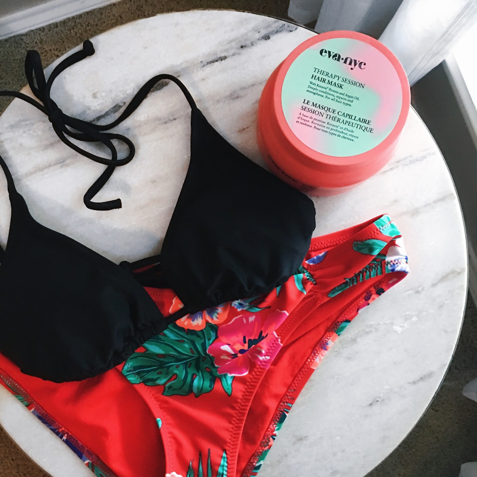 Summer essentials, black swim top, flora swim bottoms, Eva NYC hair therapy mask