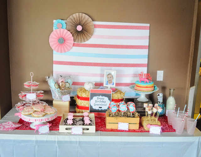 Snack table and backdrop for a charlotte's web theme birthday party