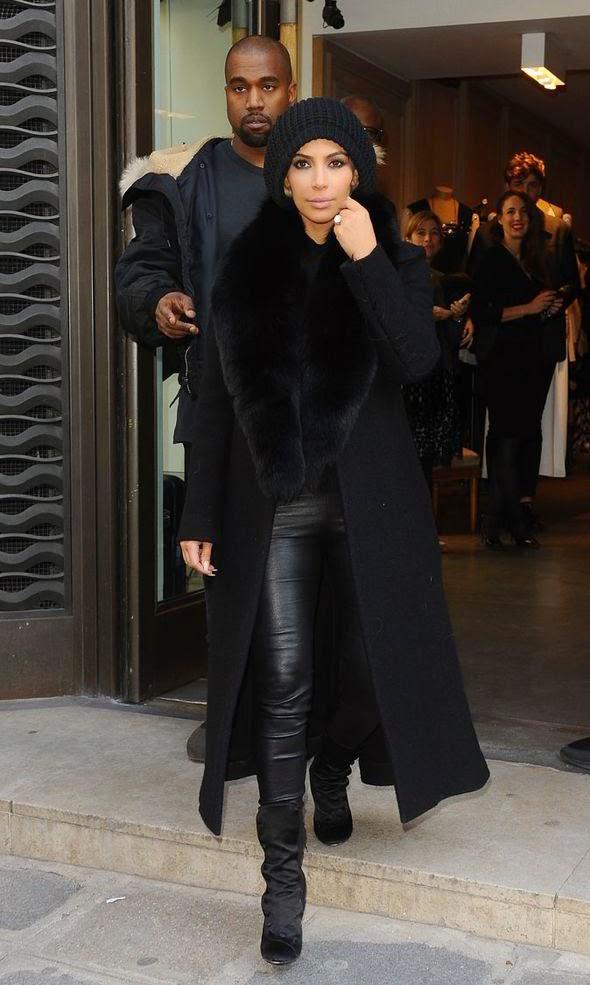 Kim Kardashian tenta esconder seus cabelos de platina em Paris