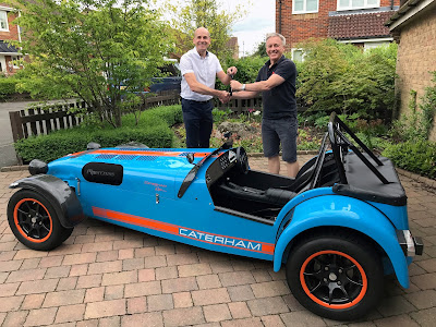 Handing over the keys of my Caterham R500 Duratec to Cliff Malone, the new owner.