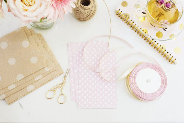 Flatlay showing string, ribbon and scissors