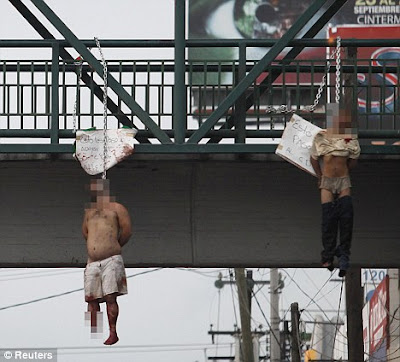 drug gangs hang rival members from city center bridge