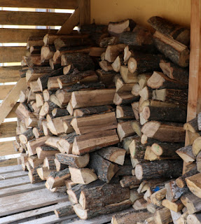Bought logs stacked up outside