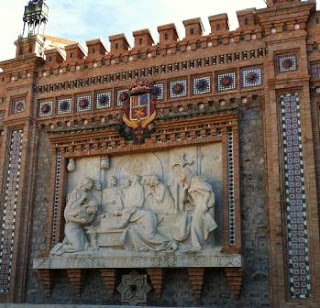 "A memorial to the tragic story of ""The Lovers of Teruel"" is further decorated with various shapes, sizes and colors of ceramic tile."