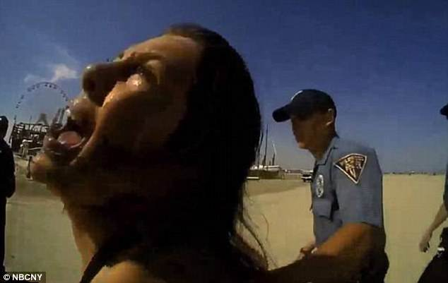 Viral video show a Mom, 20, being beaten by cops in front of her 18-month-old daughter on a New Jersey beach