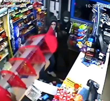 CCTV footage shows the moment a brave UK store owner fought back as two armed robbers tried to steal from him
