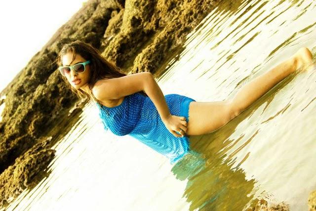 Actress Sri Reddy Latest Photoshot Stills in Transparent Wet Blue Dress at Beach