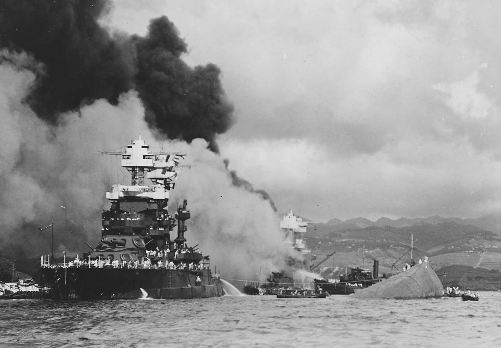 The USS Maryland, a battleship moored inboard of the USS Oklahoma, which capsized, was damaged slightly in the Japanese attack on Pearl Harbor on December 7, 1941.