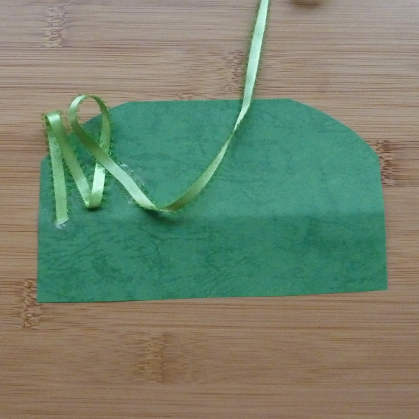 Green colored card and ribbon