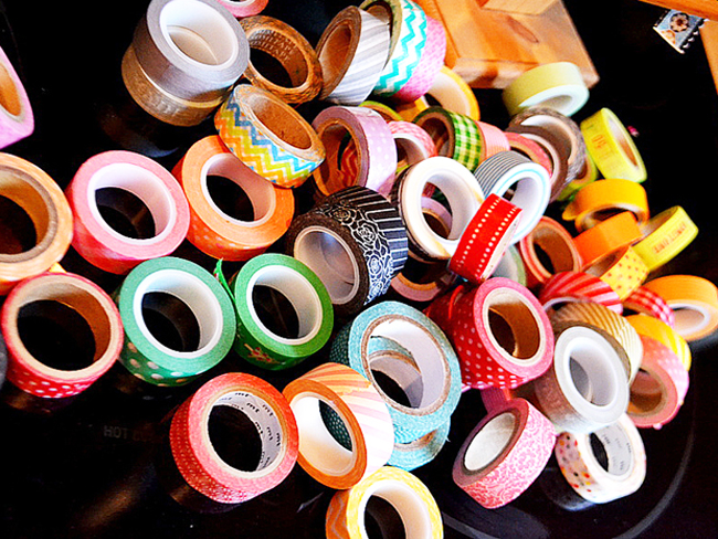 pile of washi tape, how to make washi tape easter eggs, craft supplies