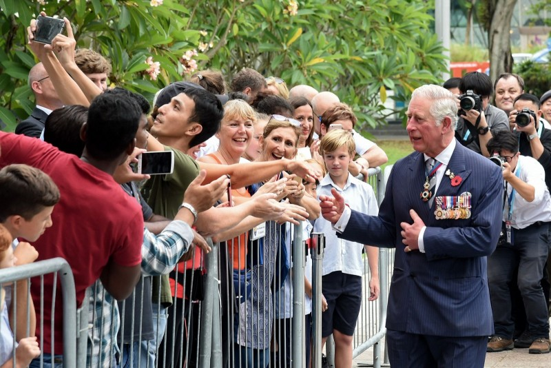 Britain's Prince Charles, Prince of Wales greets members of the public after the wreath laying ceremony at The Cenotaph war memorial in Singapore on October 31, 2017.