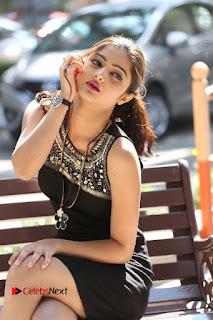 Actress Poojitha Pallavi Naidu Stills in Black Short Dress at Inkenti Nuvve Cheppu Movie Platinum Disc Function  0167.JPG