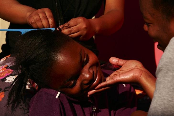 Girl having her hair made