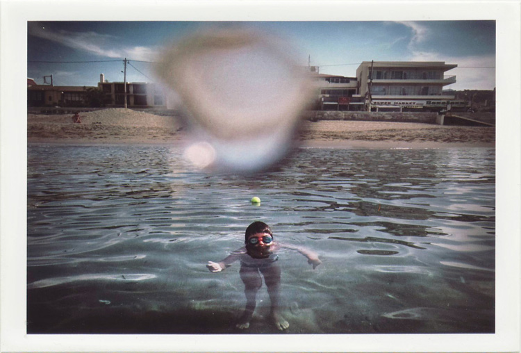 dirty photos - on the island ofphoto of boy inside sea and water bubble