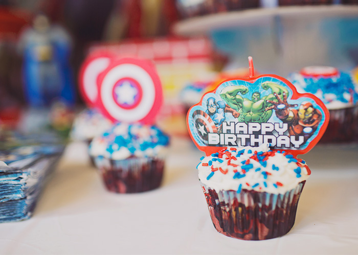 Avengers birthday cupcakes with character candles