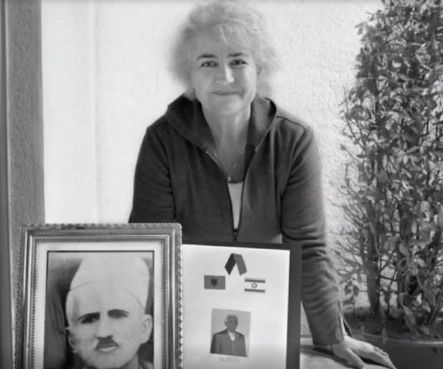 Higmet Zyma with the portrait of her husband Besim Zyma