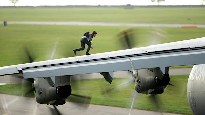 Ethan Hunts jumps on to a moving ariplane, in Mission: Impossible - Rogue Nation (2015), directed by Christopher McQuarrie