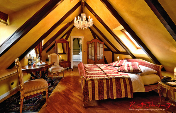 Interior photography of a luxuriously furnished attic room. Boutique Hotel photography in Prague by Kent Johnson.