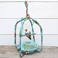 http://www.pillarboxblue.com/gorgeous-spring-fabric-birdcage/