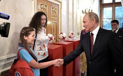 Vladimir Putin greeting a girl before the Council for the Development of Physical Culture and Sport.