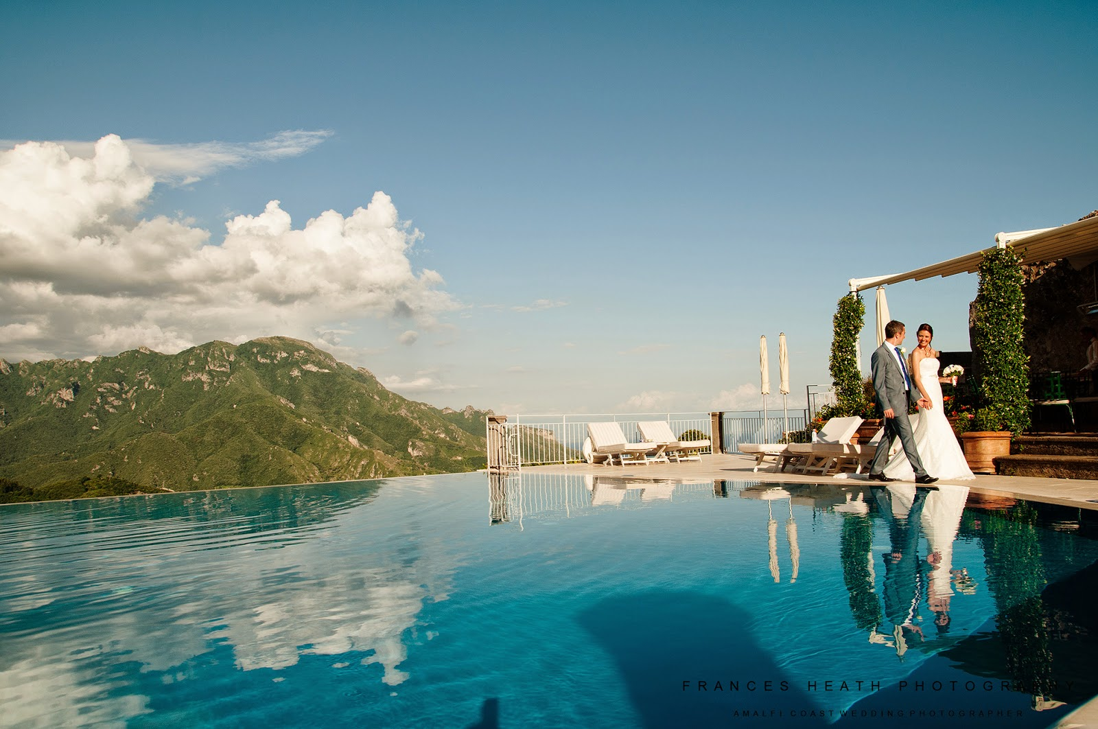 Bride and groom at the Infinity pool in Hotel Caruso