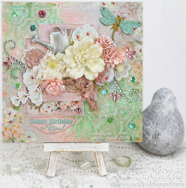 Spring garden mixed media card by Tracey Sabella for ScrapBerry's. https://bit.ly/2pKONX4 #scrapBerrys #finnabair  #primamarketing #mixedmedia #mixedmediacard #shabbychic #shabbychiccard #lindysstampgang #usartquestprills #artanthology #helmar