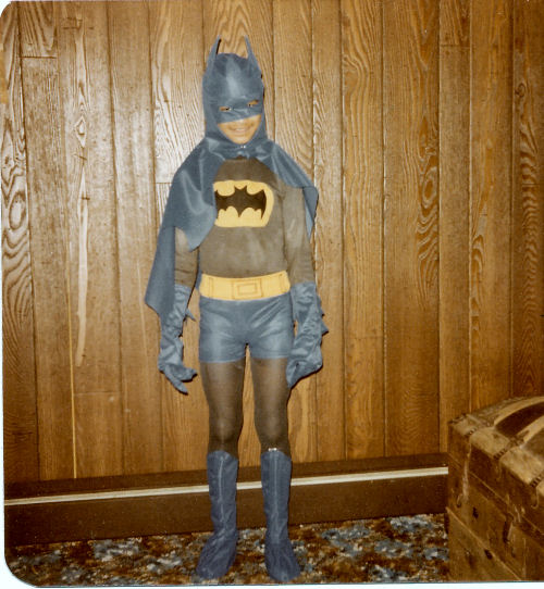 thin boy in Batman costume