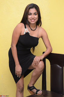Vrushali Gosavi in strapless Short Black Dress At Follow Follow U Audio Launch 044.JPG