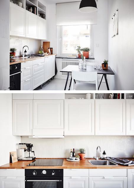 una cocina blanca al estilo nordico, con espacio muy reducido