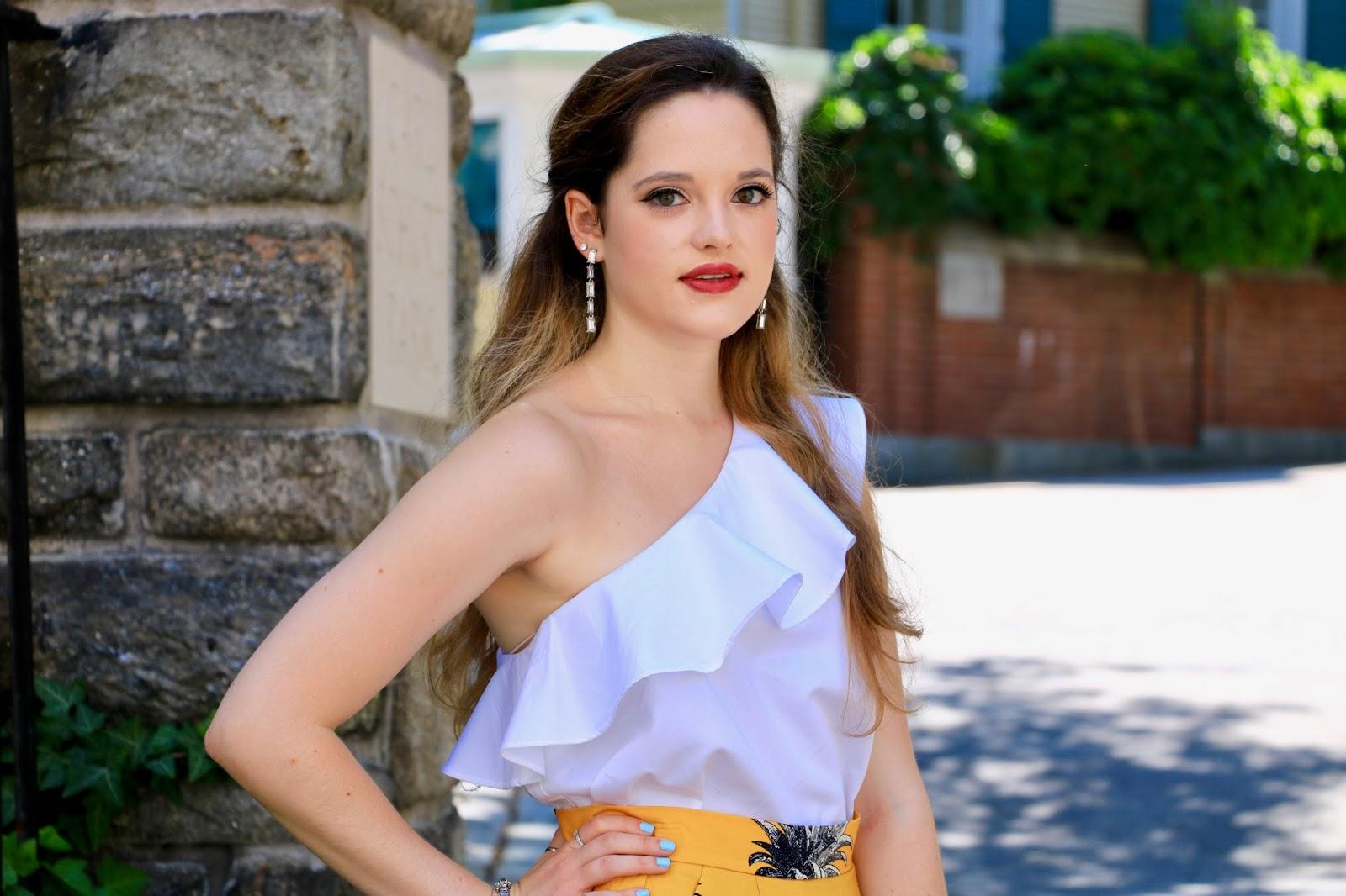 nyc fashion blogger kathleen harper wearing a one-shoulder ruffle blouse