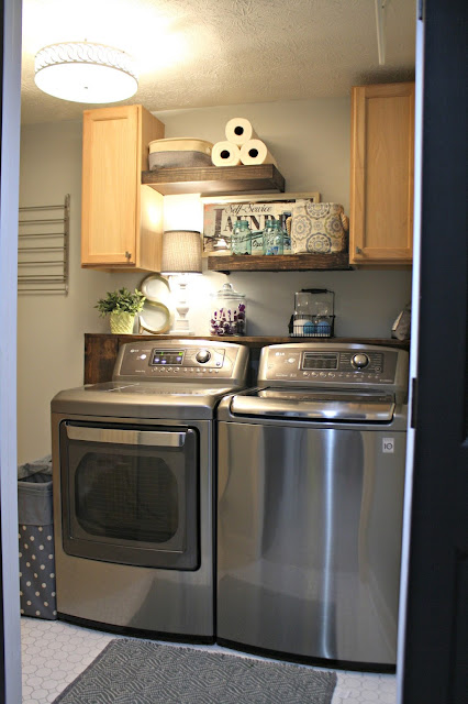 Laundry with floating wood shelves