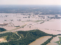 Historic flooding on the Missouri River on July 30, 1993, just north of Jefferson City, Missouri. Midwest floods in 1993 caused a 33% loss in U.S. corn production. (Image credit: Missouri Highway and Transportation Department) Click to Enlarge.