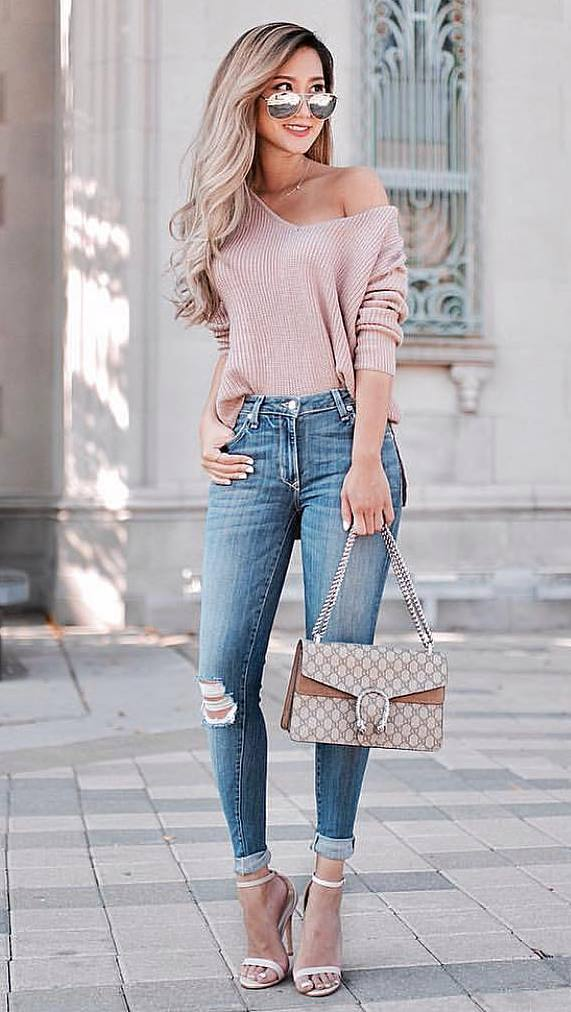 how to style an one shoulder sweater : heels + bag + skinny jeans
