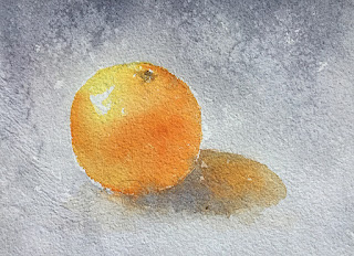 A water color painting of an orange on handmade paper
