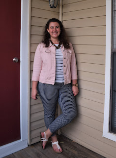an outfit with a white striped tee, navy polka dot pants, a pink denim jacket, a tortoise shell necklace, and white sandals