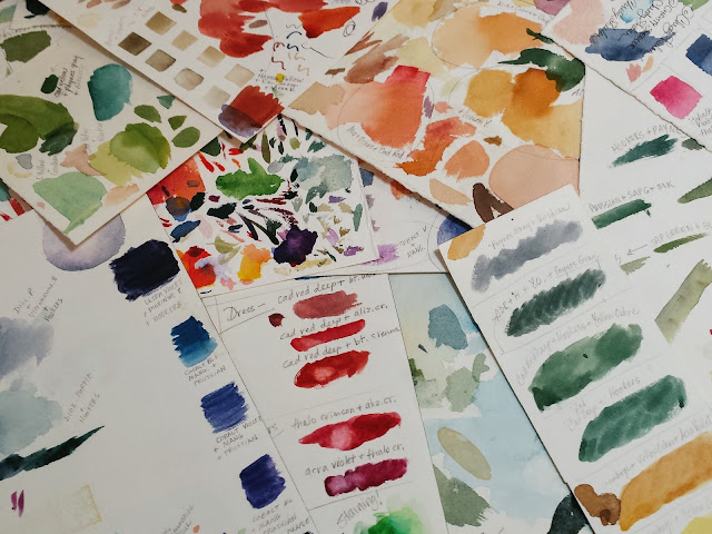 Various collected watercolor mixing grids with written notes.