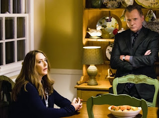 Talia Balsam and Aidan Quinn as Captain Tommy Gregson and his separated estranged wife Cheryl Gregson in CBS Elementary Season 2 Episode 6 An Unnatural Arrangement
