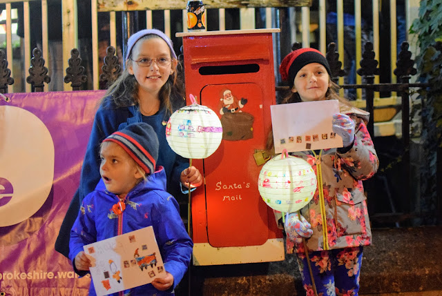 letters to Santa, Santa's postbox, nativity, stable, chips, hot chips, hot food in the dark, lanterns in the sky, twinkling lights, lantern parade, Christmas, advent, traditions, family, Pembrokeshire, Milford Haven, Santa, nativity, small town Christmas celebrations, UK, Wales, A child's Christmas in wales, light ceremony,