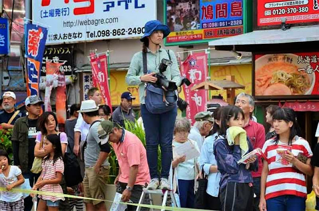 photographer on ladder,parade,Okinawa