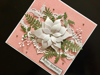 Hand made birthday card with die cut poinsettia and leaves.