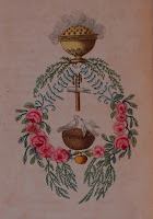 An emblem featuring a floral wreath and doves.