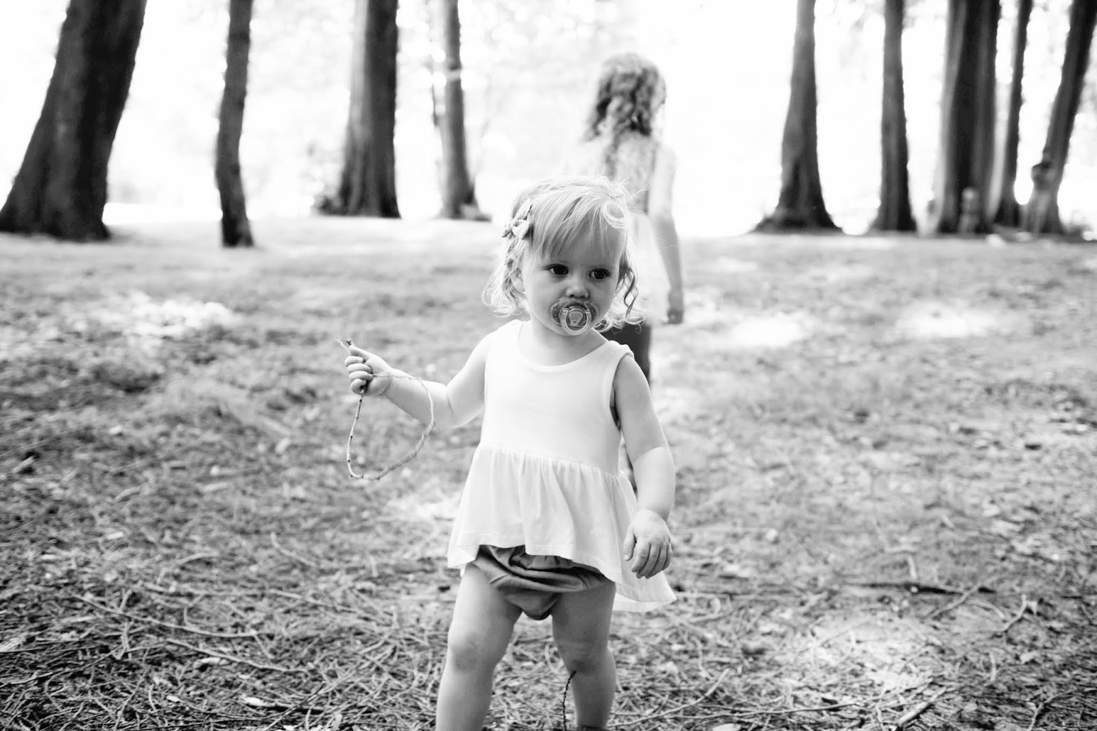 one year old explore woods pacifier black and white baby model sisters friends
