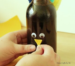 Kids Thanksgiving Craft - Make a Colorful Turkey with craft supplies and a soda bottle