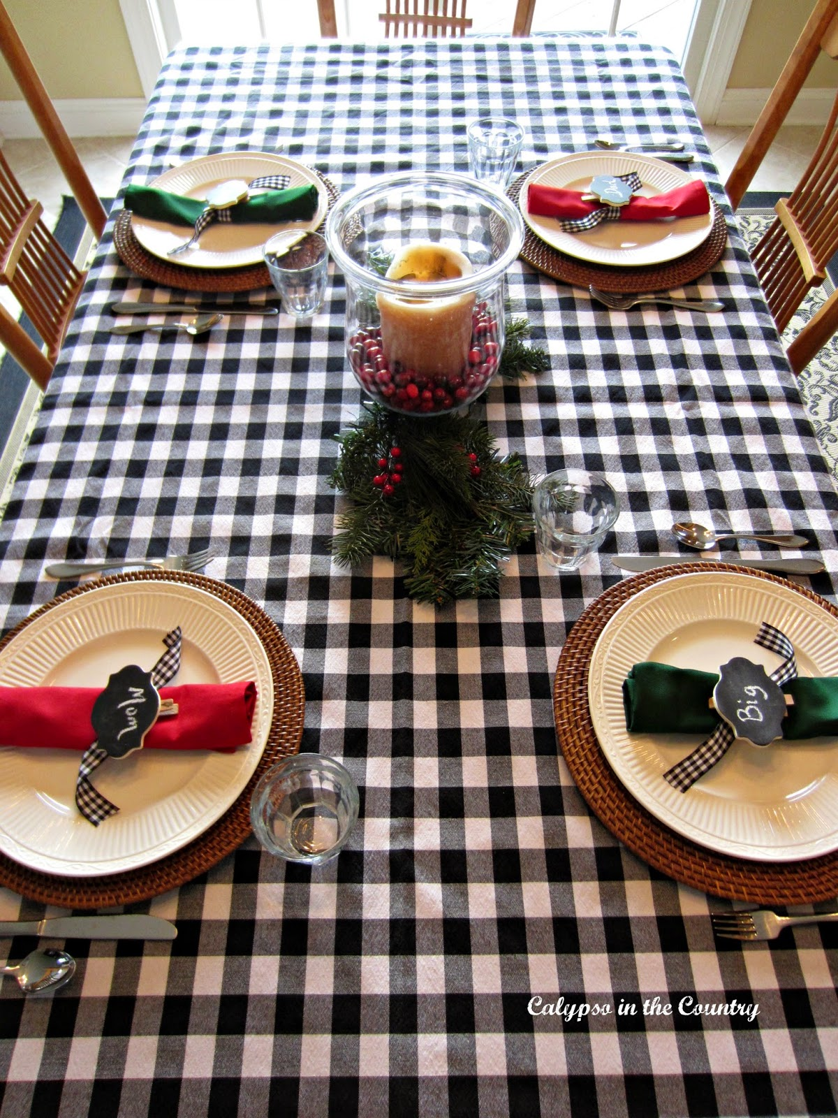 Christmas breakfast table with black and white buffalo check tablecloth.