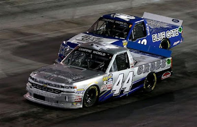 Tommy Joe Martins, driver of the #44 Cross Concrete Construction Chevrolet,  leads Daniel Hemric, driver of the #19 Blue Gate Bank Ford, in Bristol, Tennessee.